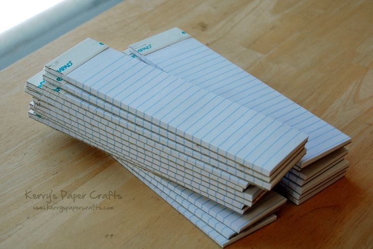 "take notepads to Staples and have them cut in half to make ""skinny"" notepads.  then cut a simple cardstock cover that is crimped about an inch on one end and attach that to make a cute little gift for someone. Looks like a great idea for Christmas or any occasion!"