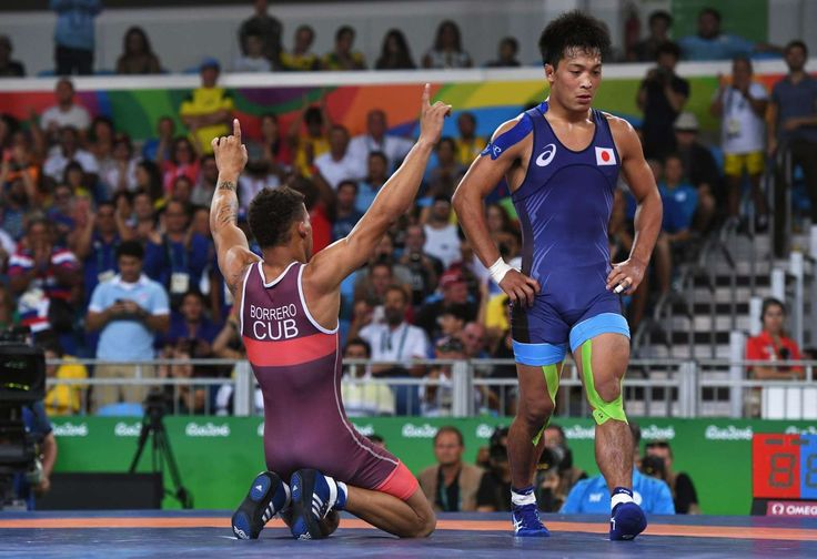 Cuba beats Japan:    Ismael Borrero Molina of Cuba celebrates after defeating Shinobu Ota of Japan in the Men's Greco-Roman 59 kg Gold Medal match.     -  2016 Rio Olympics: Highs and lows from Day 9