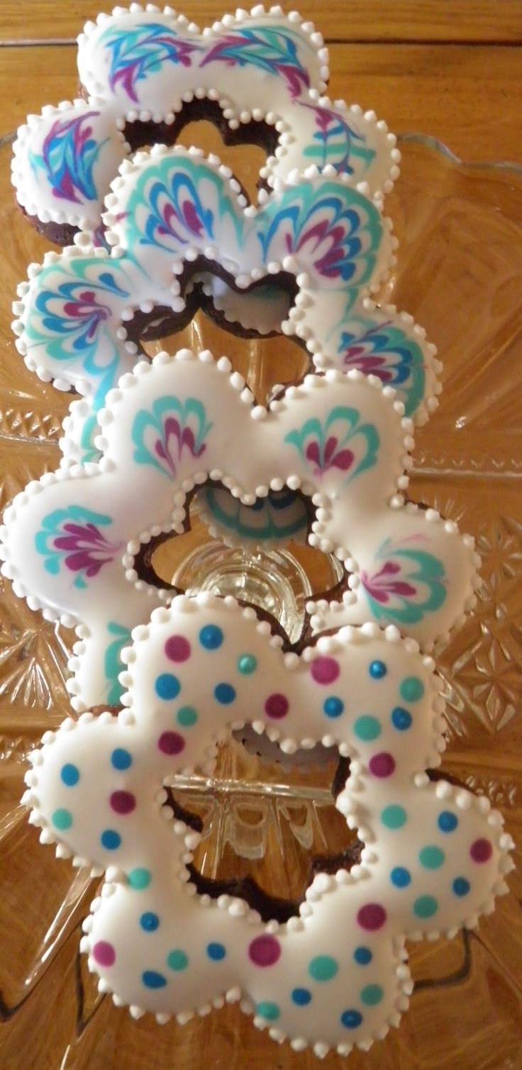 Mocha Cookies with Mocha Icing, feathered and polka dot decoration.  #sugar#cookies#iced#