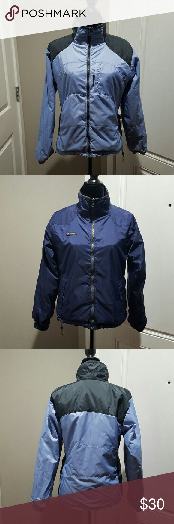 Women's reversible Columbia coat, size medium Women's dark blue reversible to a light blue Columbia coat.  Size medium.  There are no stains or tares on the dark blue side. The only Discoloration is on light blue side on the cuffs, shown in picture.  No tares or anything on the light blue side. Columbia  Jackets & Coats