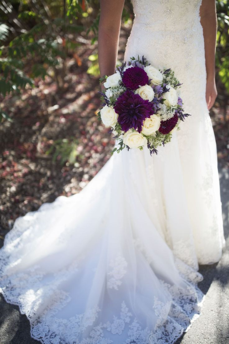 This bouquet features stunning purple Dinner Plate Dahlias with ivory roses and other botanical greens. Dahlias are perfect for fall weddings in Milwaukee!
