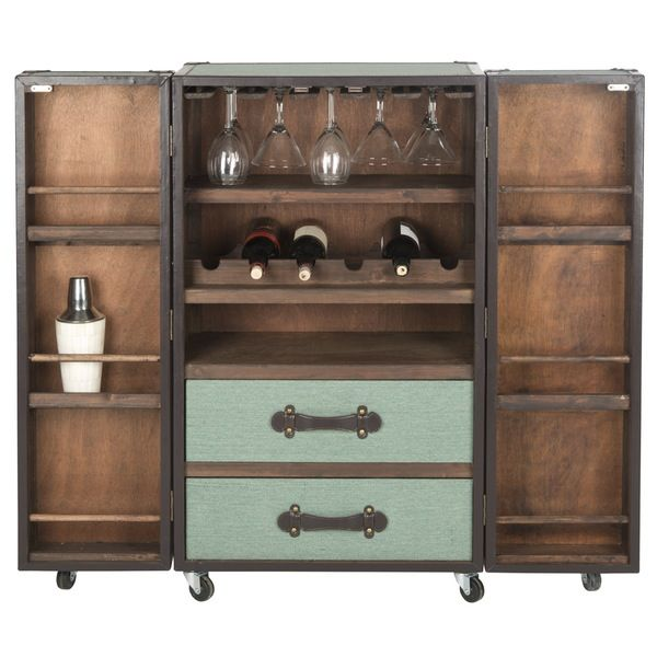 With the classic good looks of a British steamer trunk, the Lexington bar cabinet opens to reveal a wine and liquor cabinet hidden inside. Upholstered in beige linen with brown PU leather trim, this clever piece is fitted with two drawers and glass rack. On casters for easy portability, this bar cabinet is finished with reinforced corners with brass nail heads.