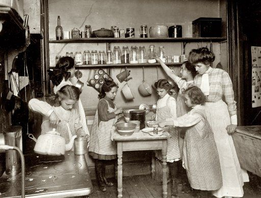 """Home economics in public schools. Kitchen in housekeeping flat, New York,"" circa 1910."