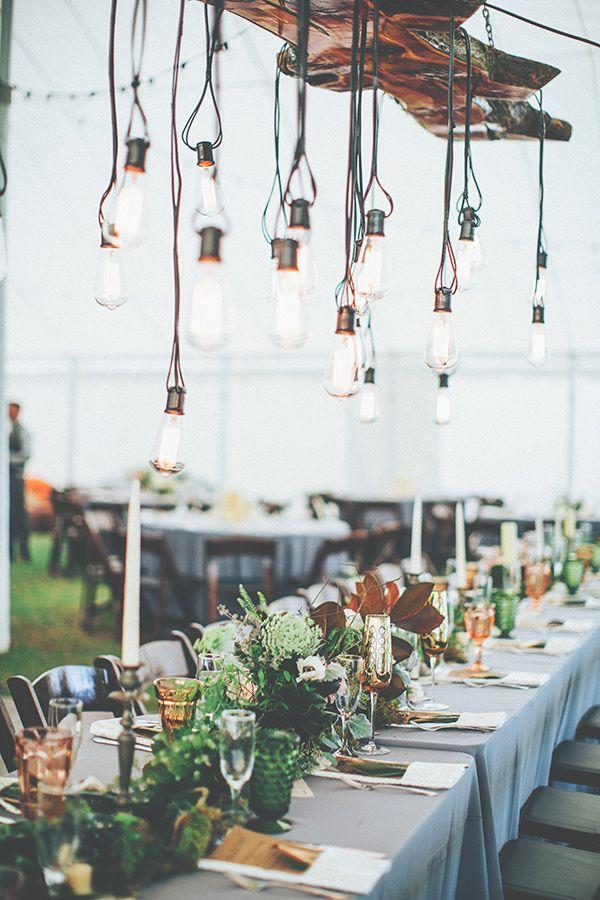 wedding reception with hanging bulbs, photo by Papered Heart Photography http://ruffledblog.com/brooksville-florida-wedding #weddingideas #weddingreception #tablescapes
