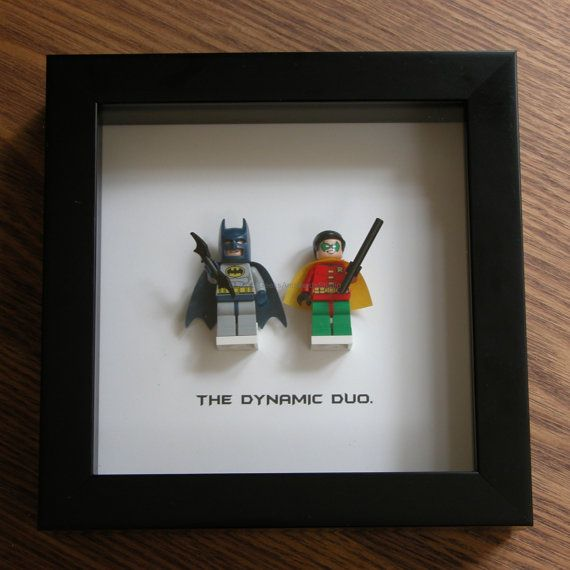 Art frame feature two LEGO® Superhero minifigures, Batman and Robin with the famous quote: 'The Dynamic Duo' beneath. Its the perfect gift for any occasion—birthday gift, wedding gift, anniversary gift, valentines day gift, graduation gift, just because gift. Popular with fans of the Superman® films and LEGO® lovers. An awesome gift for that special nerdy someone, kids, or as a little treat for yourself, or for a wedding party.  Frame size: 6 inch x 6 inch (15.2cm x 15.2cm) Frame color…