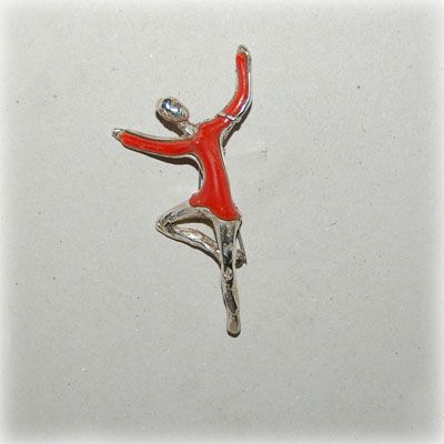Authentic red coral resembling a ballerina, with handmade sterling silver details. Entirely handmade in our workshop.