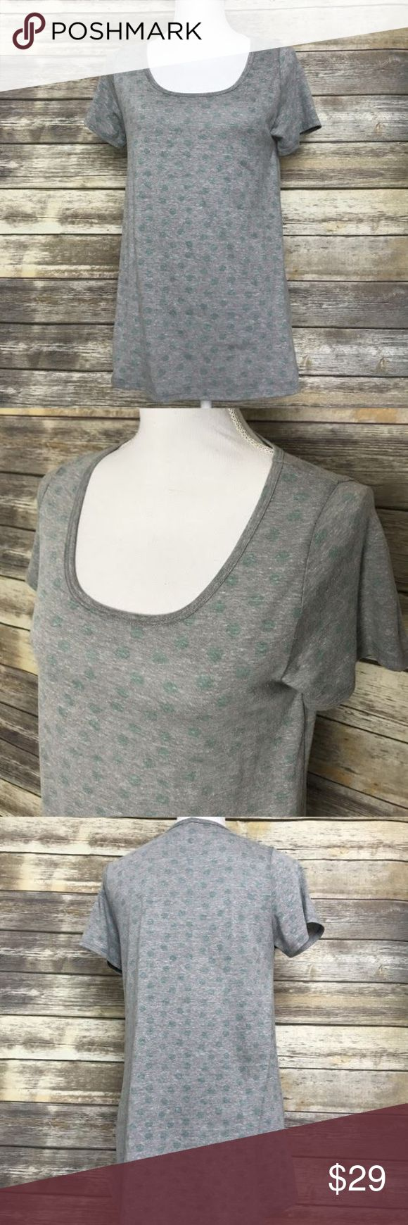 LULAROE Heather Gray Polka Dot Shirt Size Small S LULAROE Women's Heather Gray w/ Green Polka Dots Short Sleeve Shirt Size Small S  Great Condition. Item has been cleaned and is stored in a smoke free environment.   50% Polyester, 38% Cotton, 12% Rayon. No holes or stains.  Approximate Measurements: Bust (Pit to pit): 18 inches Length of garment: 29 1/2 inches LuLaRoe Tops Tees - Short Sleeve