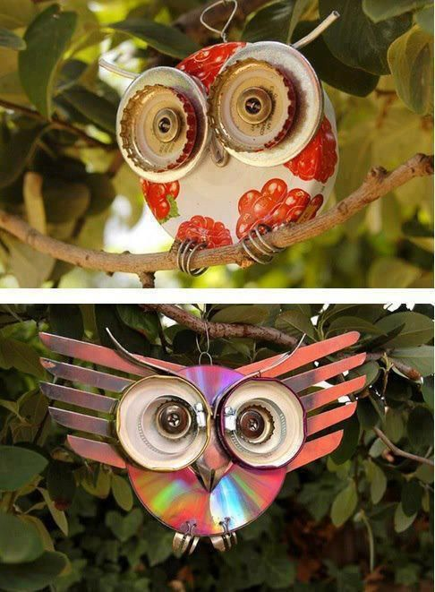 Garden decorations made from old jar lids, bottle tops, cds, buttons, cutlery & other bits and bobs.