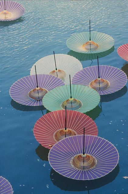 Hiroshima umbrellas. Taken in 2005 on the 50th anniversary of the bombing of Hiroshima. The river that the umbrellas are floating peacefully on was used by the victims to try to cool their burns, burns which had never been experienced before in human history | Photo Anthony Georgeff