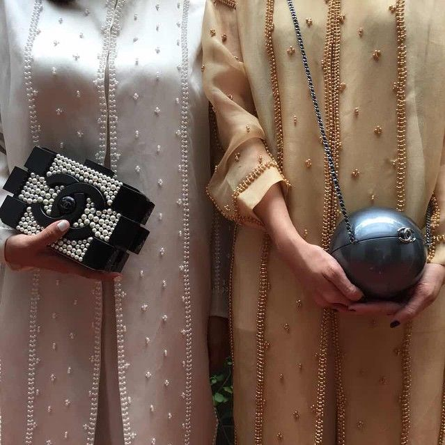 Still in the spirit of #kraveEid, get some #KRAVESAVE goin' till June 30th. Wear the magnificent @saptodjojokartiko kaftans and @chanelofficial collector's arm handle, now available for purchase.
