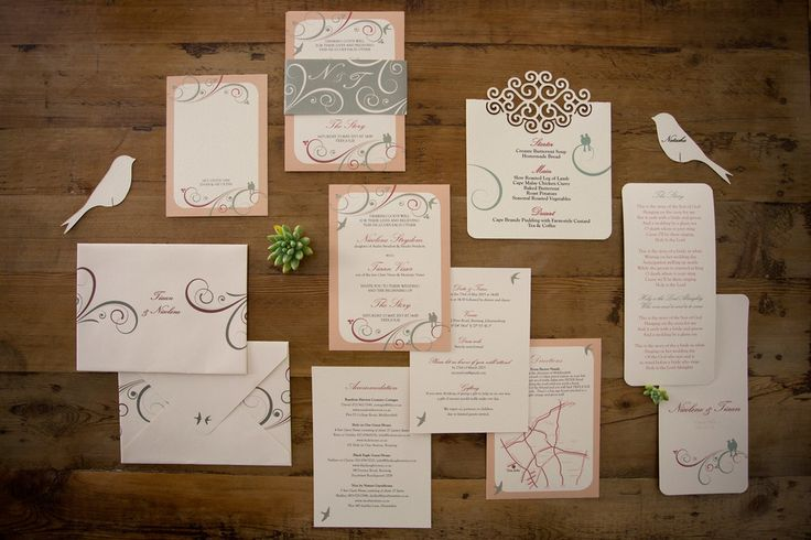Ivory, mint and marsala bird and swirl wedding stationery suite. Ivory textured menu with swirl cut-out detail. Invitation with mint belly band. Hand-folded vintage v-shape envelopes. Bird cut-out glass topper place-card. Styling by Jani Venter. Photo by Rikki Hibbert.