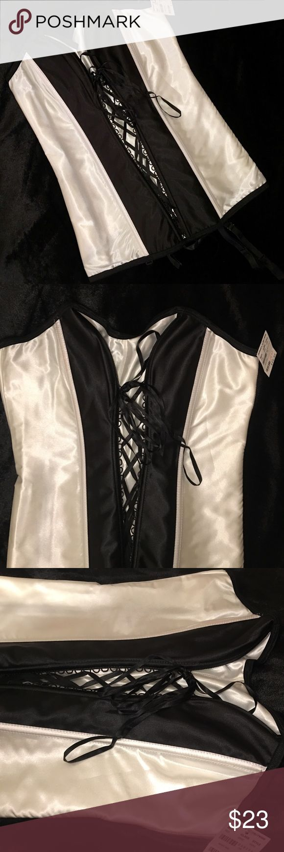 NWT Fredericks of Hollywood lace up corset!!🔥 NWT Fredericks of Hollywood lace up corset!!🔥 Gorgeous lingerie set in black and off-white!!❤️ brand new with org. tags attached!! Fredericks of Hollywood Intimates & Sleepwear