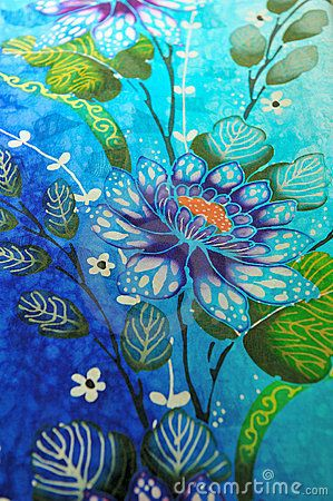 This image was made in a batik shop in kuala lumpur, the fabric has a decoration floral with the dominance of blue and blue colors, the photograph could have a decorative use or tourist.