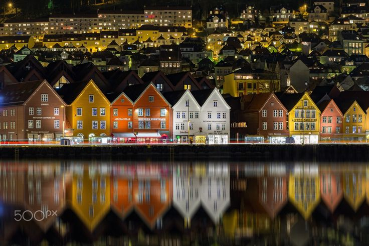 """Old Wharf Reflections - A view of the UNESCO World Heritage site """"Bryggen"""" in Bergen, Norway reflecting in the calm water."""