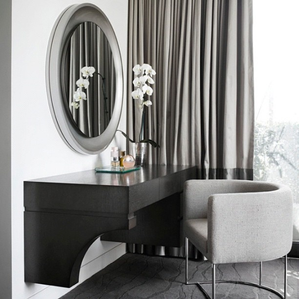 love the oval, silver mirror and neutral palette.