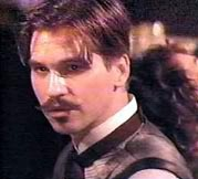 """Doc Holiday: """"Ah, yes. Well, this happens to be a nocturne."""" Billy Clanton: A which? Doc Holliday: """"You know, Frederic fucking Chopin."""""""