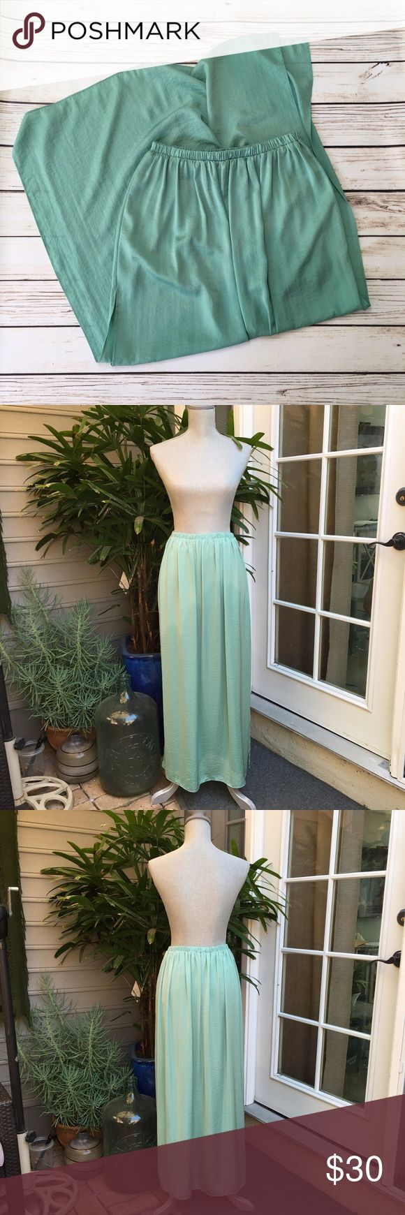 ZARA Mint Maxi Skirt ZARA Mint Maxi Skirt. Worn once. As is. In excellent condition. Elastic waistband. Thigh high slits on both sides. Zara Skirts Maxi