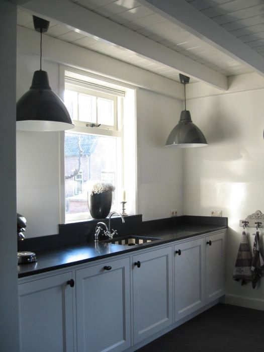 black worktop grey cabinet