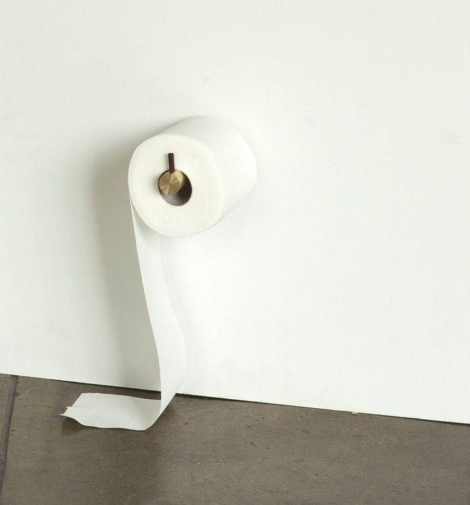 The Roll With It toilet roll holder is available in brass with a stainless steel or walnut peg or in aluminum with a brass or walnut peg; $120 at Assembly Design.