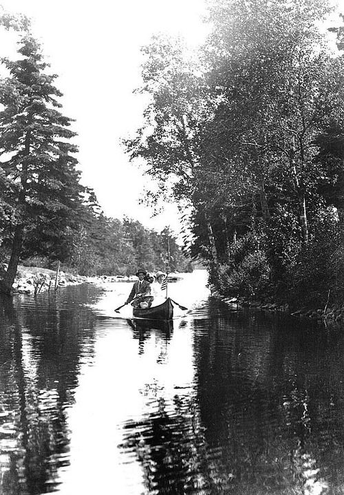 """Canoeing on the Dartmouth Lakes, Dartmouth, Nova Scotia""Source:Nova Scotia Information Service"