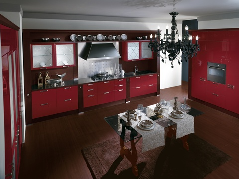 Baccarat. A thrilling metropolitan  interior. Wax Red gloss lacquered and Dark Oak wood. For a very  striking composition that transforms the kitchen into a temple of taste, expressing style and personality.