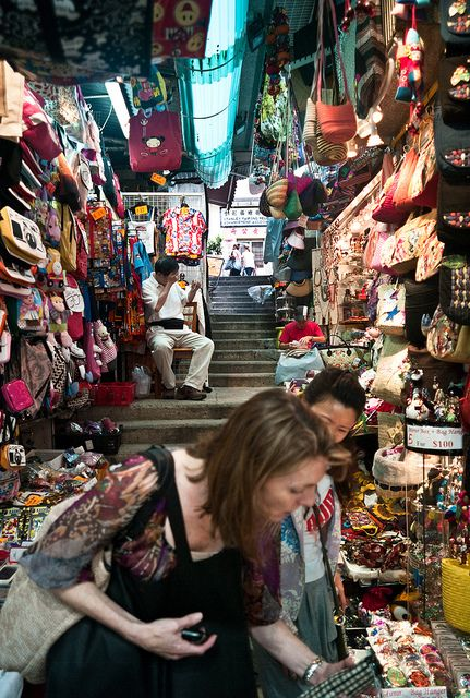 Stanley Market  clothes, shoes, silk garments and traditional Chinese dress, as well as toys, ornaments, luggage, souvenirs and arts-and-crafts, and although it is quite touristy, it is still a popular destination for both tourists and locals.    By Ed Lam, via Flickr