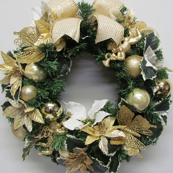 An elegant Christmas wreath. Cream and gold poinsettia combine with golden butterflies and Victorian cupids in a classic colour combination.