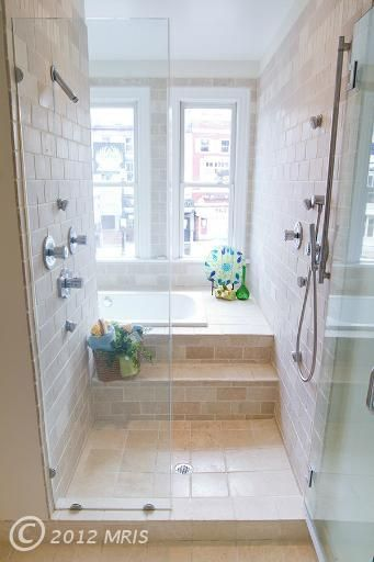 like this idea of a combo bath and walk in shower, would make it a more recessed walk in though so you don't need the glass partitions