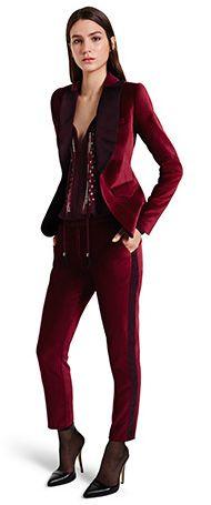 Altuzarra at Target – Velvet Blazer in Ruby Red, $59.99, Embroidered Blouse in Red, $44.99, Velvet Ankle Tuxedo Pant in Red, $39.99, Ankle Strap Shoe in Black, $39.99.