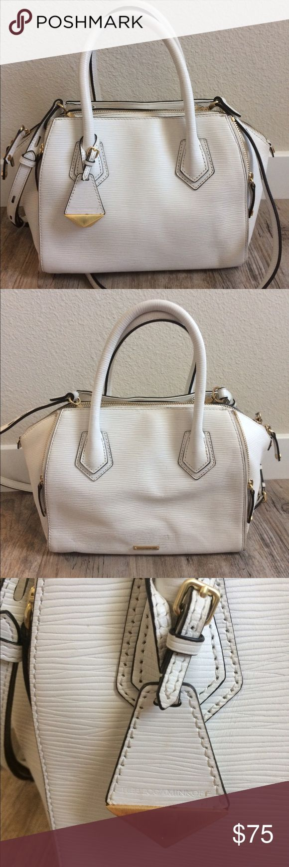 """$395 Rebecca Minkoff 'Mini Perry' White Satchel White, waved embossed leather Removable shoulder straps Main zip closure Side zips to extend Magnetic side pockets Measures approximately: total length across 13"""" inside depth 6""""  Does have some signs of wear- one side has some light marks throughout, perhaps from rubbing on denim. Some light marks on the sides and bottom and on corner. One of the foot protectors broke off/missing. Refer to photos. Has not been cleaned/treated. Some light wear…"""