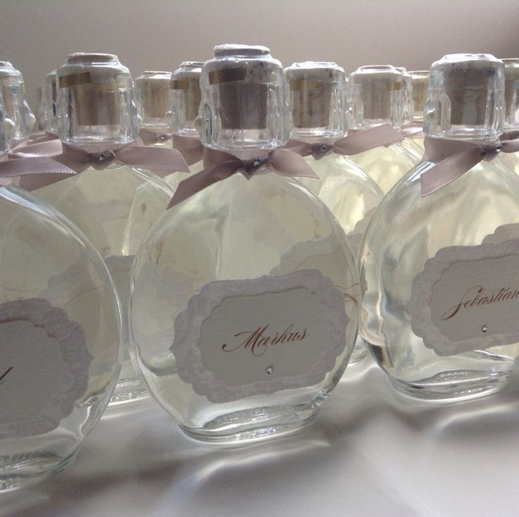 Bottles filled with Pear schnaps, embellished with name tag