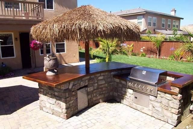 If you're designing yourself your new BBQ island, locate it at least five feet from the house and a bit far from the dining area to have plenty of space to move between the cooking area and the rest of the yard. #DIYBBQ