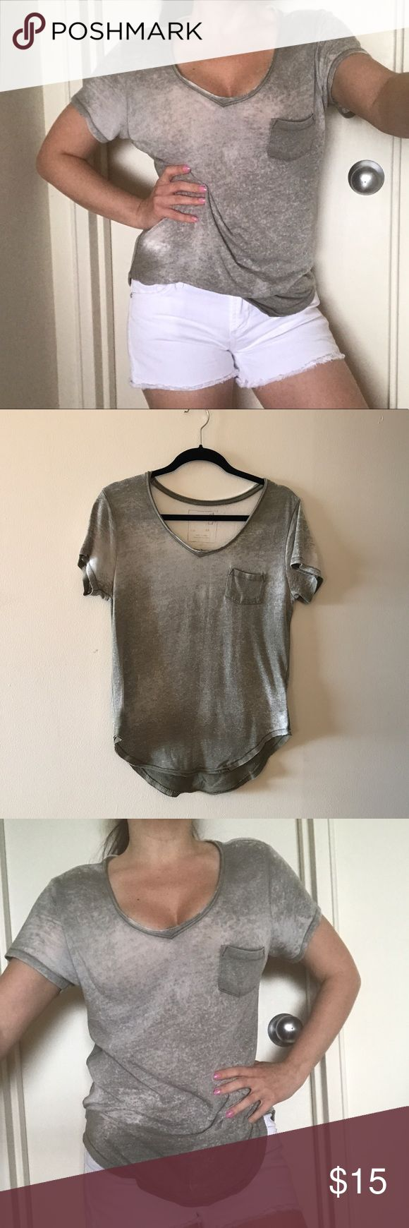Free people oversized green burnout T-shirt  XS We the free by Free people oversized factory distressed army green burnout T-shirt . Size XS. EUC. 50% Cotton, 50% Polyester. Super soft. Free People Tops Tees - Short Sleeve