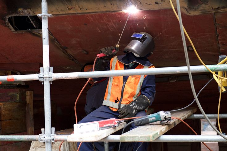 Engineers completing replacement of a small section of the hull plate on the historic steam tug William C, Daldy in 2015