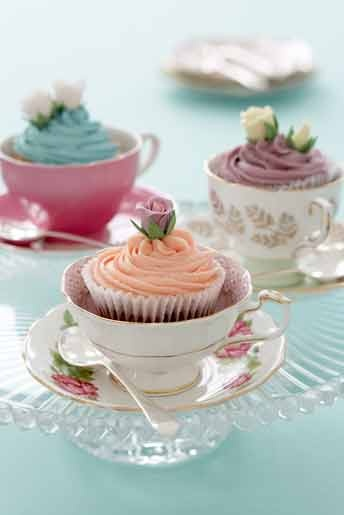 afternoon tea: cupcakes popped into vintage teacups with a serving spoon on the saucer--cool