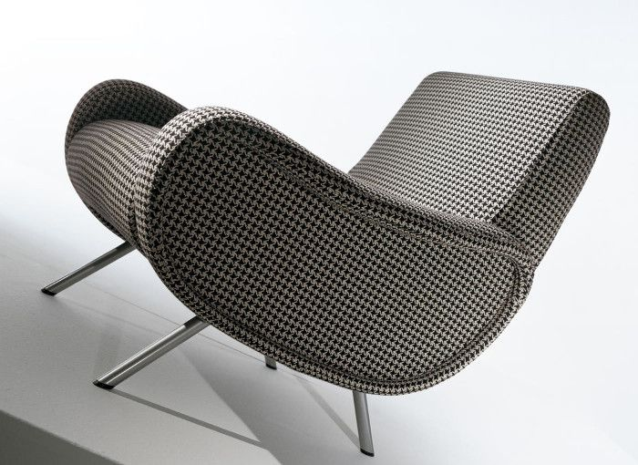A terrific example of sensual modern, the Lady Chair (1951) came about when A...