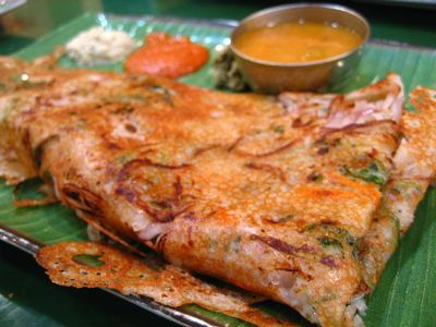 Onion Rava Dosa  Rava – 2 cups Rice Flour – 2 cups Onions – 5, big, finely chopped Green Chillies – 5 to 6, finely chopped Ginger – 1 one inch piece, peeld, grated Black Peppercorns – 1 tsp Cumin Seeds – 1/2 tsp Salt as per taste Asafoetida Powder as per taste Oil as required