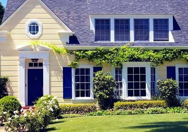 Dark Blue Shutters Pale Yellow Cottage Style Home With Blue Door