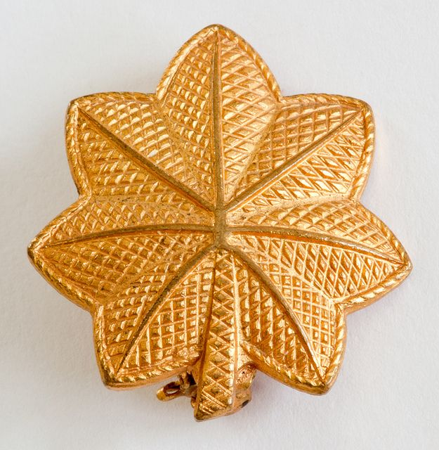 1940s World War II golden oak leaf emblem, signifying the rank of major, worn by Curtis Strand on his military uniform, 9th United States Army Air Forces, 6th Tactical Air Command USAAF by thstrand, via Flickr