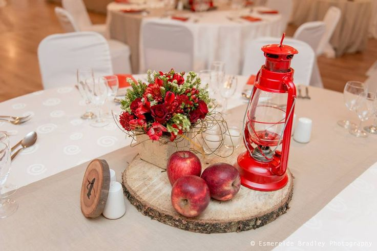 Camping themed red and taupe centrepieces