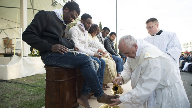 The pontiff is marking Good Friday with a traditional services, but on Holy Thursday, he broke with tradition by washing the feet of migrants of many faiths.