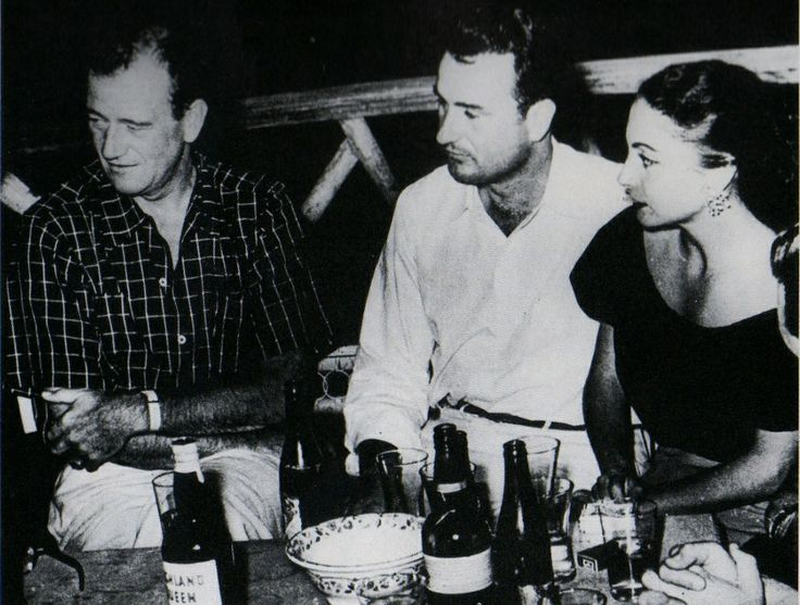 John Wayne In Peru With Richard Weldy, His Tour Guide, And Weldy' Estranged Wife Pilar Pallete. Duke And Pilar Fell In Love, She Was 29 Years His Junior, And They Married In 1954 As Soon As His Divorice From Chata Became Final.