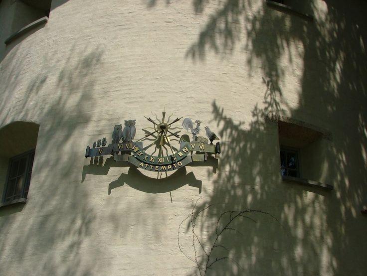 The wrought iron sundial shows 13Uhr45 in Isny im Allgäu.