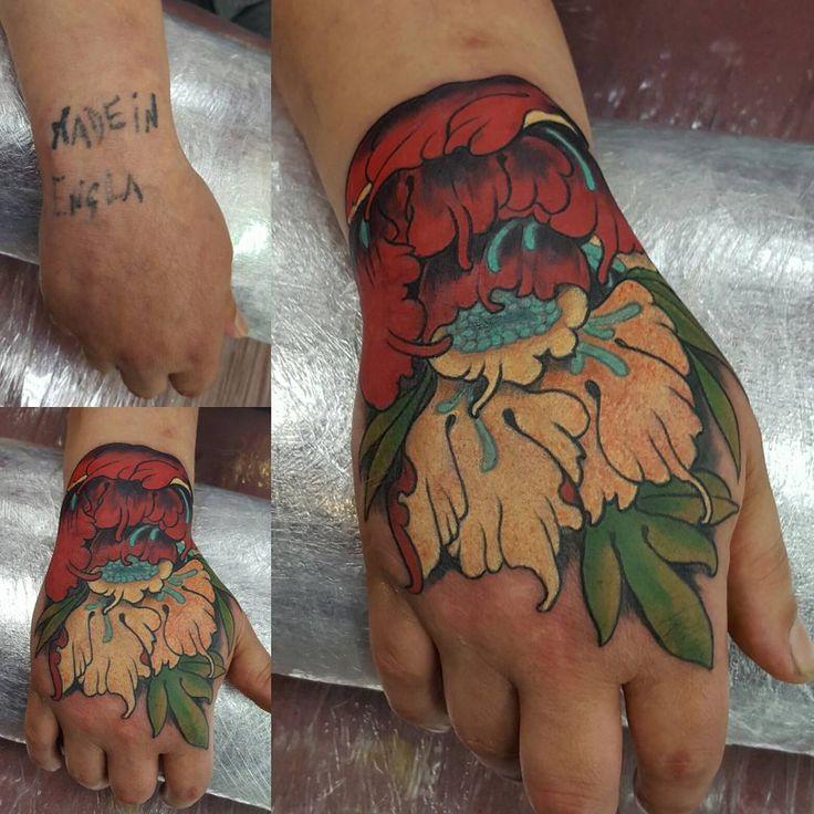 Fantastic hand piece by Zack Chiswell created with #magnumtattoosupplies. 👏🏿👏🏿  #japanesetattoo #japanesetattoos #chrysanthemum #peonytattoo #radiantcolorscrew #orientaltattoodesign #orientalart #orientaltattoo #asiantattoo #asian_inkandart #tattoo_artwork #tattoo_art_worldwide #sumi #zackchiswell #familyink #familyinktattoo #tattoo #tattoos #uktta #txttooing