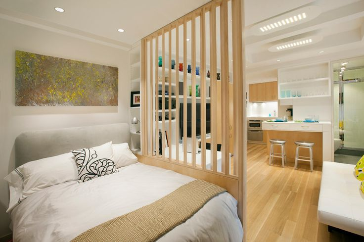 Louvered dividing wall lets light in yet still separates the bedroom in the 340 ft2 NYC studio