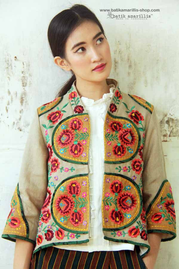 Batik Amarillis made in Indonesia proudly presents :Batik Amarillis's Arcana embroidery jacket with Batik Tuban piping ...Stand out in the crowd with this unique and stunning jacket!this contemporary & yet vintage style is accented with exquisite full Hungarian embroidery  also features triangle arcana tassels to complete the whole extravangant work of art!.