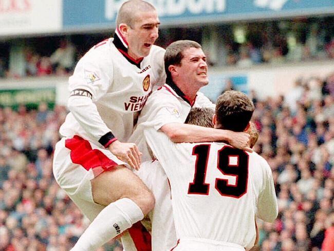 Manchester United Captain Eric Cantona, (L) Roy Keane (C), & Ronnie Johnsen in away gear.