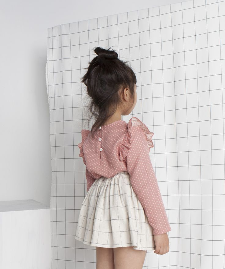 White grid skirt and pink flutter top
