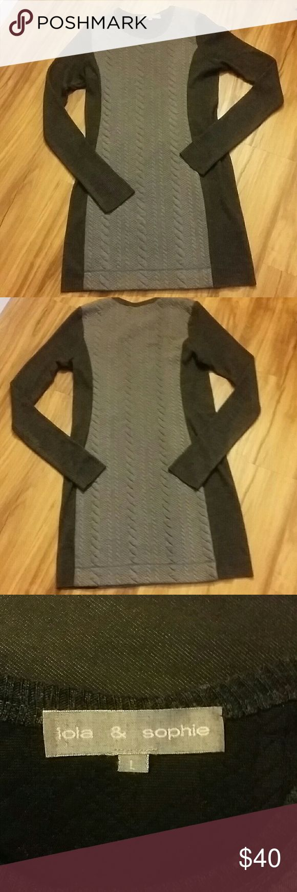 """Adorable sweater dress from Lola and Sophie This is an adorable sweater dress in excellent condition from the high end boutique in New York Lola and Sophie. Long sleeve sweater dress is black and grey. Even has thumb holes in the sleeves. Measures 35"""" from shoulder to bottom. Please see pic 4 for material info. Lola and Sophie Dresses Midi"""