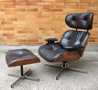 Eames style black leather recliner and ottoman. By Selig